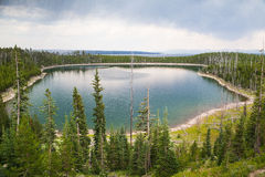 Calm surface Duck Lake in Yellowstone forest Royalty Free Stock Photos