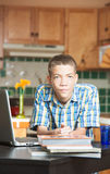 Calm teen with books and computer on table Royalty Free Stock Image