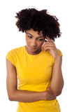 Calm and thoughtful curly haired young woman Stock Photography