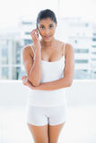 Calm toned brunette phoning Royalty Free Stock Photo
