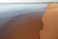 Calm transparent sea and the sandy beach Stock Image