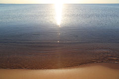 Calm transparent sea and the sandy beach Royalty Free Stock Images