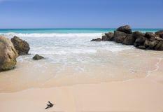 Calm tropical beach. Photo of a tropical beach with rocks of lava (Hawaii Stock Photography