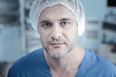 Calm unshaken patient being in the operational and looking straight. Im ready. Calm unshaken handsome patient being in the operational and looking straight Stock Images