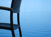 Calm vacation. Wicker chair detail infront of calm sea Stock Photo