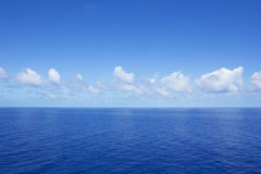 Calm Vibrant Blue Ocean. The vibrant blue photo of the calm clear ocean Royalty Free Stock Image