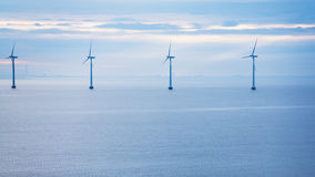Calm water of Baltic Sea with offshore wind farm Royalty Free Stock Image