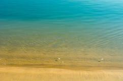 Calm water on beach Stock Photos