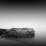 Calm water. Black & white daytime long exposure rocky seascape  with beautiful sky and sea. Black sea, Odessa, Ukraine Royalty Free Stock Images
