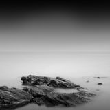 Calm water. Black & white daytime long exposure rocky seascape  with beautiful sky and sea. Black sea, Odessa, Ukraine Stock Image