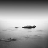 Calm water. Black & white daytime long exposure rocky seascape  with beautiful sky and sea. Black sea, Odessa, Ukraine Royalty Free Stock Photo