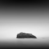 Calm water. Black & white daytime long exposure rocky seascape  with beautiful sky and sea. Black sea, Odessa, Ukraine Stock Images