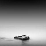 Calm water. Black & white daytime long exposure rocky seascape  with beautiful sky and sea. Black sea, Odessa, Ukraine Royalty Free Stock Photography