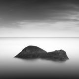 Calm water. Black & white daytime long exposure rocky seascape  with beautiful sky and sea. Black sea, Odessa, Ukraine Stock Photos