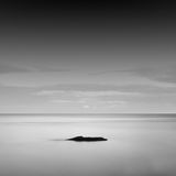 Calm water. Black & white daytime long exposure rocky seascape  with beautiful sky and sea. Black sea, Odessa, Ukraine Royalty Free Stock Image