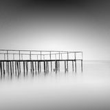 Calm water. Black & white daytime long exposure seascape with beautiful sky and objects in the sea. Black sea, Odessa, Ukraine Stock Images