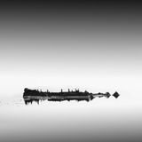 Calm water. Black & white daytime long exposure seascape with beautiful sky and objects in the sea. Black sea, Odessa, Ukraine Stock Photo
