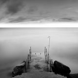 Calm water. Black & white daytime long exposure seascape with beautiful sky and objects in the sea. Black sea, Odessa, Ukraine Royalty Free Stock Image