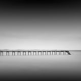 Calm water. Black & white daytime long exposure seascape with beautiful sky and objects in the sea. Black sea, Odessa, Ukraine Royalty Free Stock Images