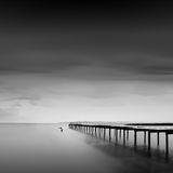 Calm water. Black & white daytime long exposure seascape with beautiful sky and objects in the sea. Black sea, Odessa, Ukraine Royalty Free Stock Photos