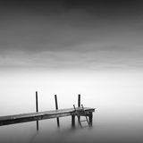 Calm water. Black & white daytime long exposure seascape with beautiful sky and objects in the sea. Black sea, Odessa, Ukraine Royalty Free Stock Photo