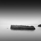 Calm water. Black & white daytime long exposure seascape with beautiful sky and objects in the sea. Black sea, Odessa, Ukraine Stock Photos