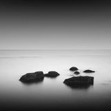 Calm water. Black & white daytime long exposure seascape with beautiful sky and objects in the sea. Black sea, Odessa, Ukraine Stock Photography