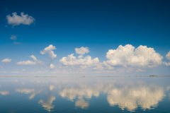 Calm Water with Clouds Stock Photos
