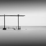 Calm water. Daytime long exposure seascape with object in the sea. The photo taken in black and white. Black sea, Odessa, Ukraine Royalty Free Stock Photography