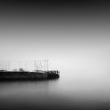 Calm water. Daytime long exposure seascape with object in the sea. The photo taken in black and white. Black sea, Odessa, Ukraine Stock Photography
