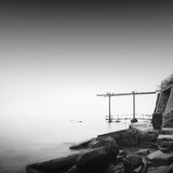 Calm water. Daytime long exposure seascape with object in the sea. The photo taken in black and white. Black sea, Odessa, Ukraine Stock Images