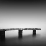 Calm water. Daytime long exposure seascape with object in the sea. The photo taken in black and white. Black sea, Odessa, Ukraine Royalty Free Stock Photos