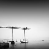 Calm water. Daytime long exposure seascape with object in the sea. The photo taken in black and white. Black sea, Odessa, Ukraine Stock Photo