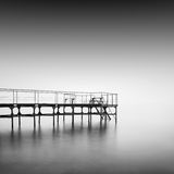 Calm water. Daytime long exposure seascape with object in the sea. The photo taken in black and white. Black sea, Odessa, Ukraine Stock Photos