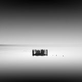 Calm water. Daytime long exposure seascape with object in the sea. The photo taken in black and white. Black sea, Odessa, Ukraine Stock Image