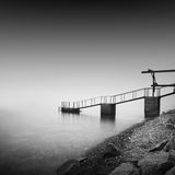 Calm water. Daytime long exposure seascape with object in the sea. The photo taken in black and white. Black sea, Odessa, Ukraine Royalty Free Stock Images