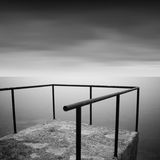Calm water. Daytime long exposure seascape with object in the sea. The photo taken in black and white. Black sea, Odessa, Ukraine Royalty Free Stock Image