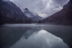 Calm Water on Lake in Valley Stock Images