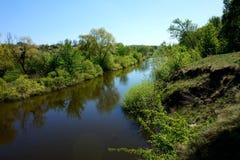 Calm water of a narrow river Samara. Ukraine.  Stock Image
