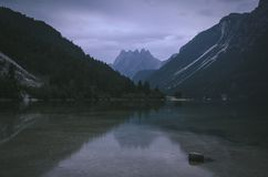 Mountain reflections at lake Predil, Italy stock photography