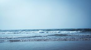 Calm Water on Seashore at Daytime Stock Images