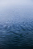 Calm Water texture on a Foggy Morning Stock Photography