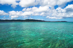 Calm waters around the island. Crusing on calm waters around quiet tropical islands Royalty Free Stock Photography