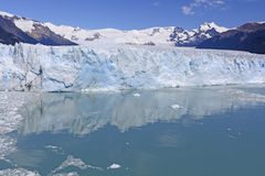 Calm Waters Below a Glacial Face Stock Photo