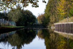 Calm waters. Canal side reflections stock images
