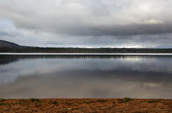 Calm waters at Loch Morlich Stock Images