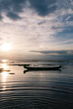 Calm Waters. And low tide at sunset in Jungutbatu village, on the island of Nusa Lembongan, Bali, Indonesia Stock Photos