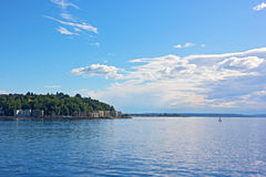 Calm waters of Puget Sound before sunset in Seattle, USA. Stock Images