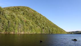 Scene On Lake O`Law On The Cabot Trail In Cape Breton, Nova Scotia. The calm waters separate sparse civilization with wilderness on the other side. The location stock video footage