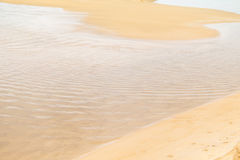 Calm wave and sand. Transparent sea water and beach sand royalty free stock photography
